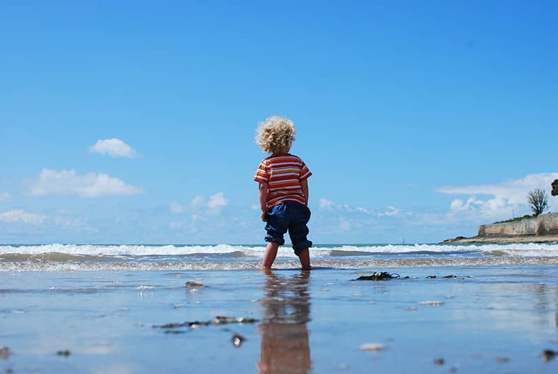Little boy at the sea shore